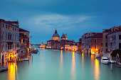 Grand Canal and Santa Maria della Salute in Venice Italy at dusk.