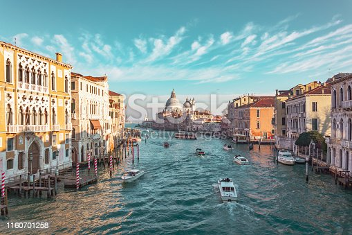 Grand Canal in Venice, Italy. View of the main street panorama of the major street of Venice, picturesque clouds in the sky. Basilica di Santa Maria della Salute