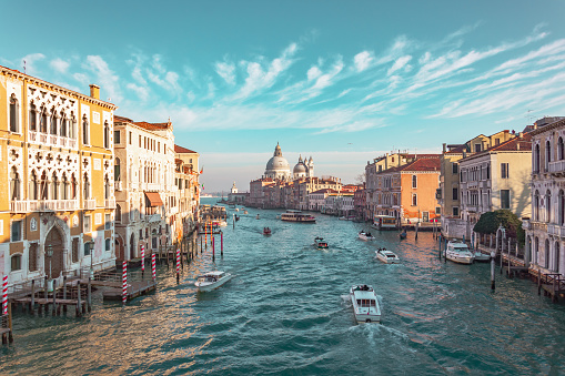 Grand Canal in Venice, Italy. View of the main street panorama of the major street of Venice, picturesque clouds in the sky. Basilica di Santa Maria della Salute.