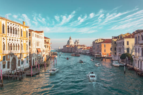grand canal in venice, italy. view of the main street panorama of the major street of venice, picturesque clouds in the sky. basilica di santa maria della salute. - della stock pictures, royalty-free photos & images