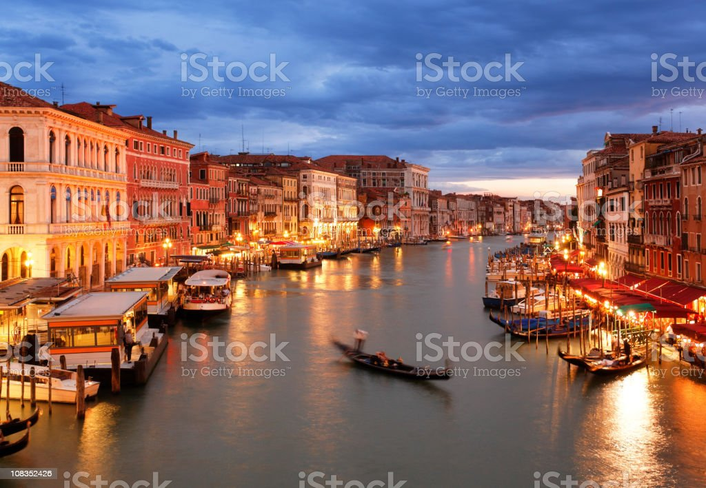 Grand Canal of Venice after sunset with gondola royalty-free stock photo