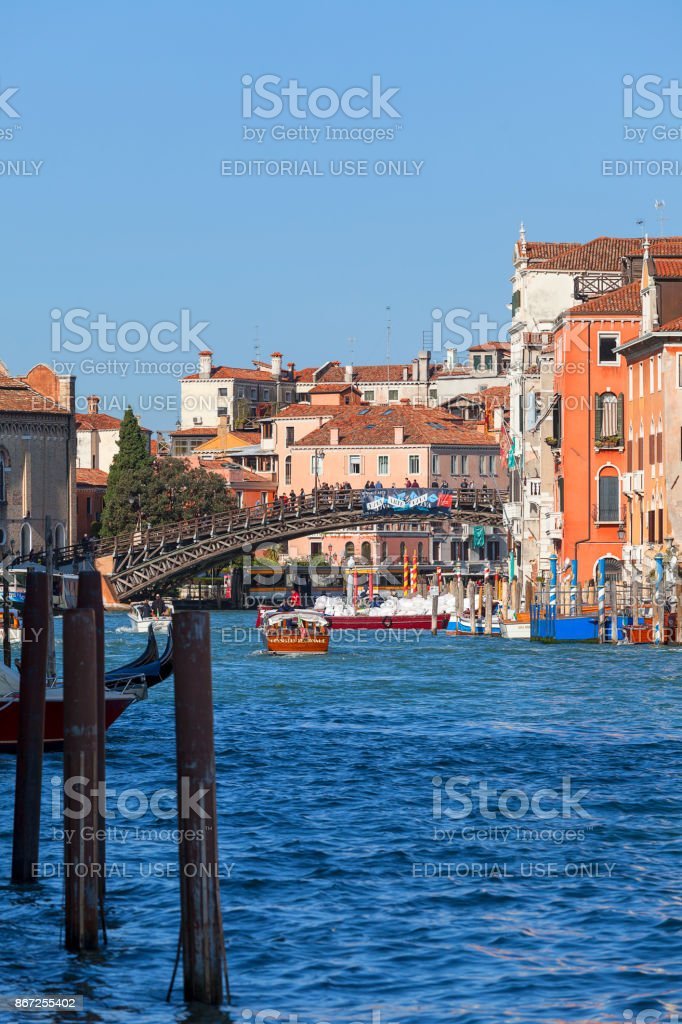 Grand Canal, Ponte dell'Accademia, vintage buildings, parked boats at the marina, Venice, Italy stock photo