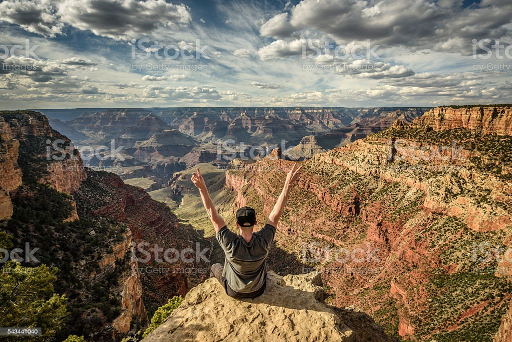 Grand Canyon and a happy hiker stock photo