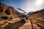 Grand Canyon, Arizona, USA - January 01, 2018: Helicopter tour over Grand Canyon and tourists exploring it.