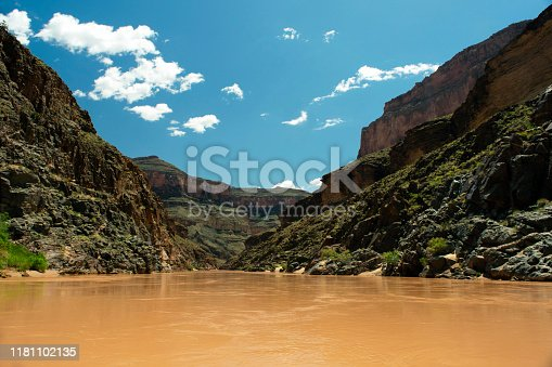 Looking down the Colorado River from the bottom of the Grand Canyon between river miles 114-117 on a spring day after rain which caused the river to turn murky and reddish in color
