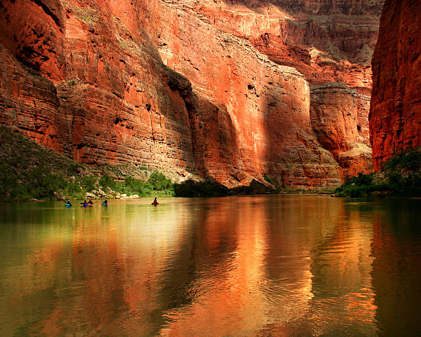 Grand Canyon Kayakers People kayaking on the Colorado river in Grand Canyon National Park colorado river stock pictures, royalty-free photos & images