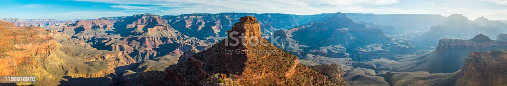 Warm light of sunrise illuminating the golden strata of Cedar Ridge and O'Neill Butte on the South Kaibab Trail down into the Grand Canyon, Arizona, USA.