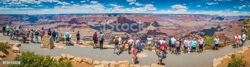 Crowds of tourists enjoying the view from Hopi Point on the South Rim across the awe inspiring vista of the Grand Canyon National Park, Arizona.