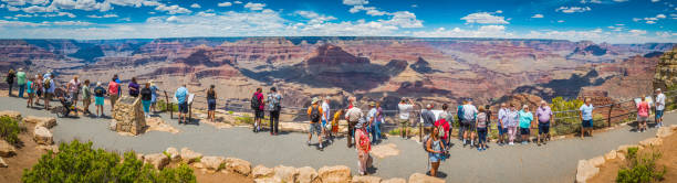 Grand Canyon panorama tourists at Hopi Point South Rim Arizona stock photo