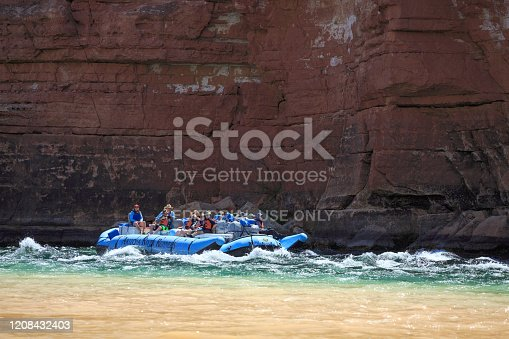 Lee's Ferry, AZ, USA - May 14, 2019: River rafters navigate the first rapids at Lee's Ferry at the beginning of their trip through the Grand Canyon.