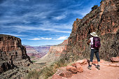 mature female hiker enjoying the view on the soutern rim of the Grand Canyon