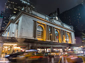 Grand Central Station in New York City with the blurry motion of cars moving past on 42nd St.