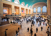 Motion blur as passengers and visitors walk through the huge interior of Grand Central Station in Manhattan, New York City.