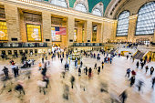 Grand Central Station, New York City, USA. Longer exposure, people are motion blurred.