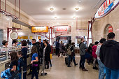 istock Grand central terminal food court restaurant in New York City with people in store shop ordering line queue, dining concourse 937833186
