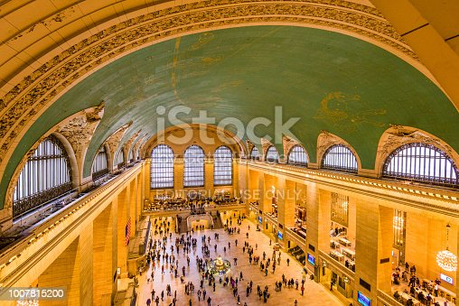 New York, New York - October 20, 2016: Commuters mill about Grand Central Terminal as viewed from above. The terminal is a  U.S. National Historic Landmark.