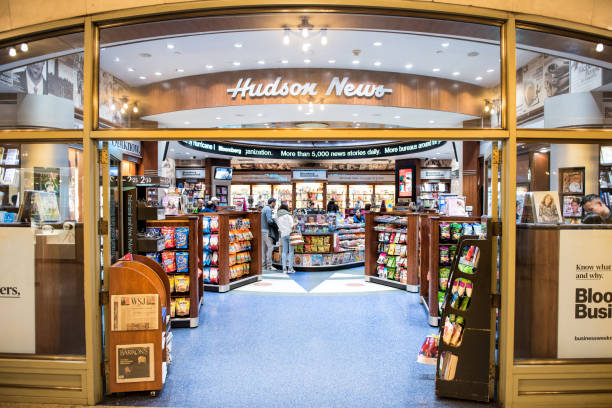 Grand central terminal subway in New York City with sign, people walking inside Hudson Group news store shop New York, USA - October 29, 2017: Grand central terminal subway in New York City with sign, people walking inside Hudson Group news store shop hudson river stock pictures, royalty-free photos & images
