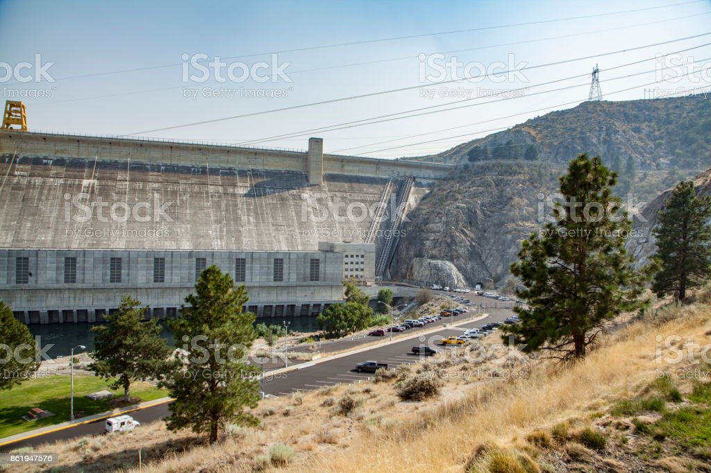 Grand Coulee Dam from the south west visitor side showing spillway and electrical lines stock photo