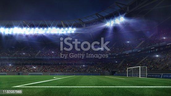istock grand football stadium illuminated by spotlights and empty green grass 1132037565