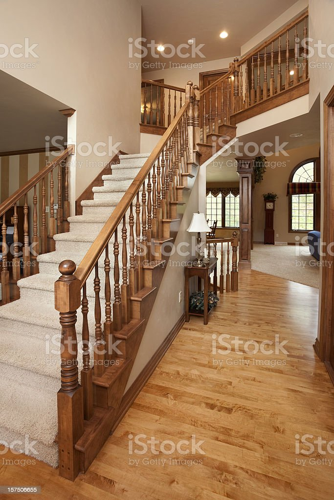 grand foyer staircase oak railing hardwood floor open