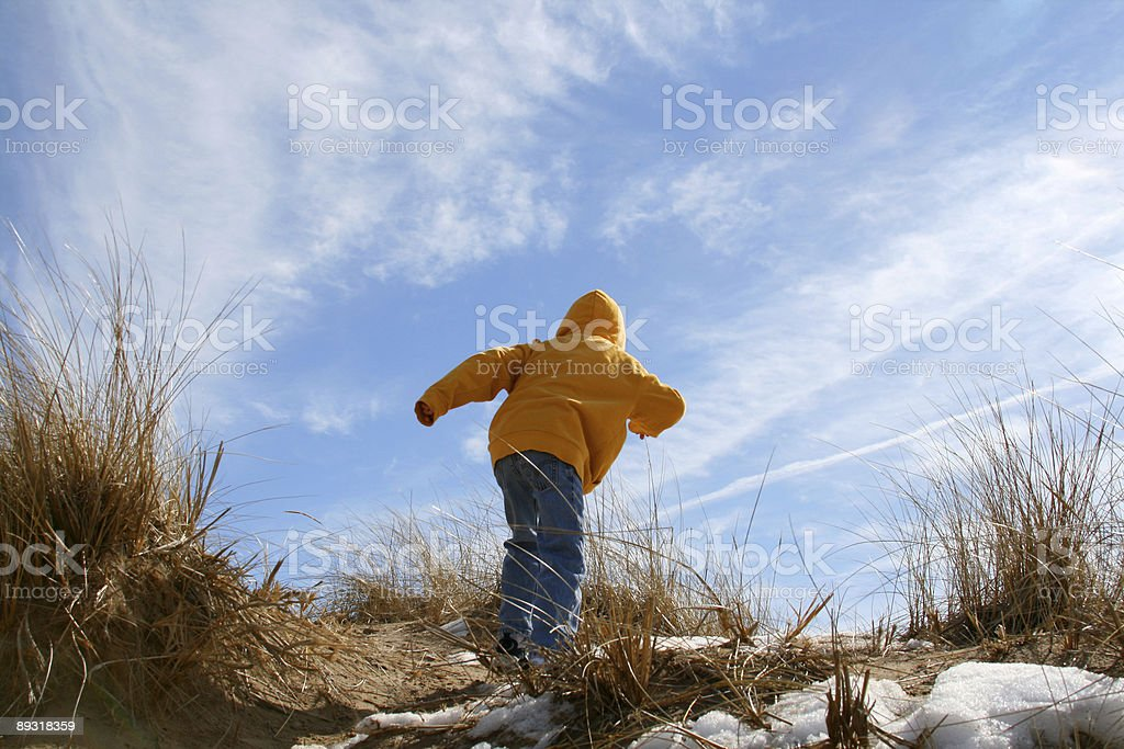 Grand Haven Michigan Dunes Ascent: Child climbs royalty-free stock photo