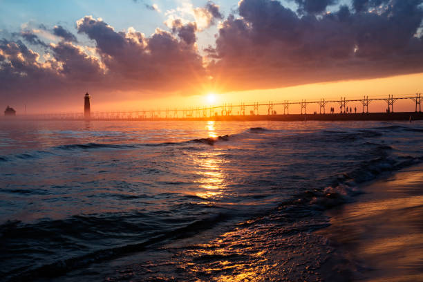 grand haven sunset - lake michigan stock pictures, royalty-free photos & images
