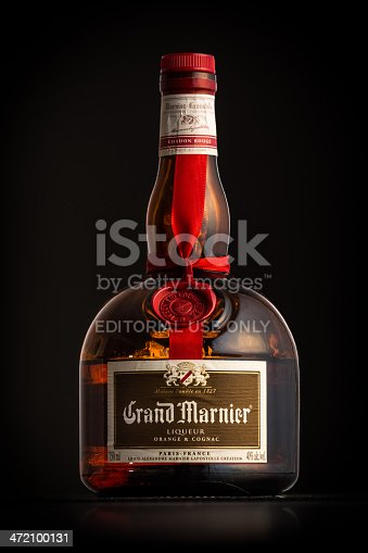 Chatham, NJ, USA - January 1, 2014: Photo of a Grand Marnier bottle. Grand Marnier Cordon Rouge is an orange-flavored cognac liqueur made of Cognac brandy, distilled essence of bitter orange and sugar.