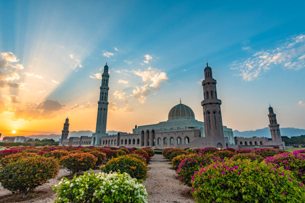 Grand Mosque Muscat Beautiful sunrise scene at Grand Mosque Muscat grand mosque stock pictures, royalty-free photos & images
