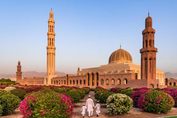 Grand Mosque Muscat The Sultan Qaboos Grand Mosque (Arabic: جَامِع ٱلسُّلْطَان قَابُوْس ٱلْأَكْبَر, romanized: Jāmiʿ As-Sulṭān Qābūs Al-Akbar) is the main mosque in the Sultanate of Oman, located in the capital city of Muscat. minaret stock pictures, royalty-free photos & images