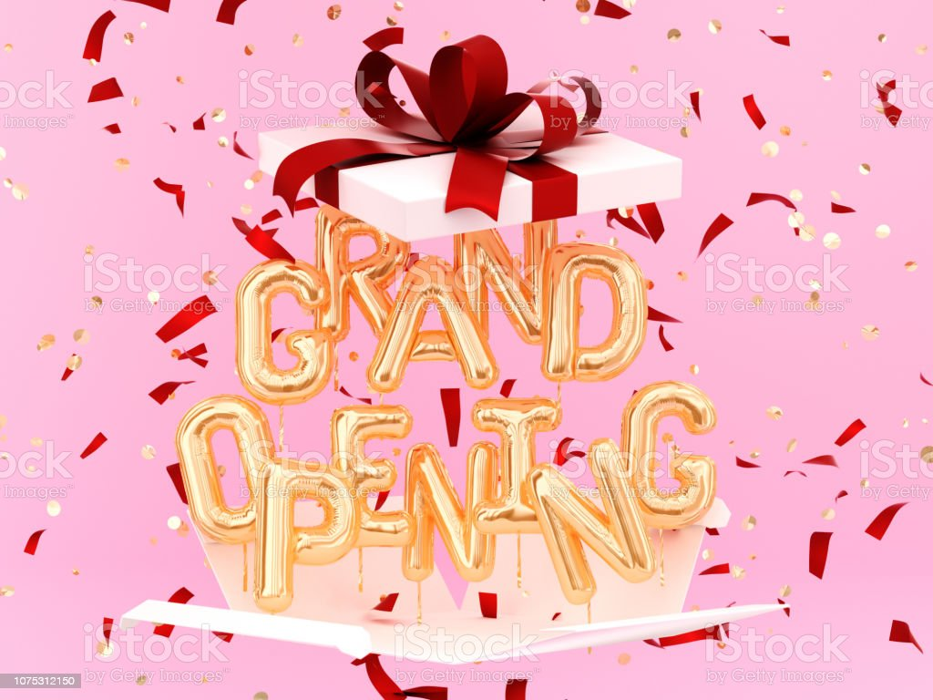 Grand Opening phrase sign letters with confetti and gift box stock photo