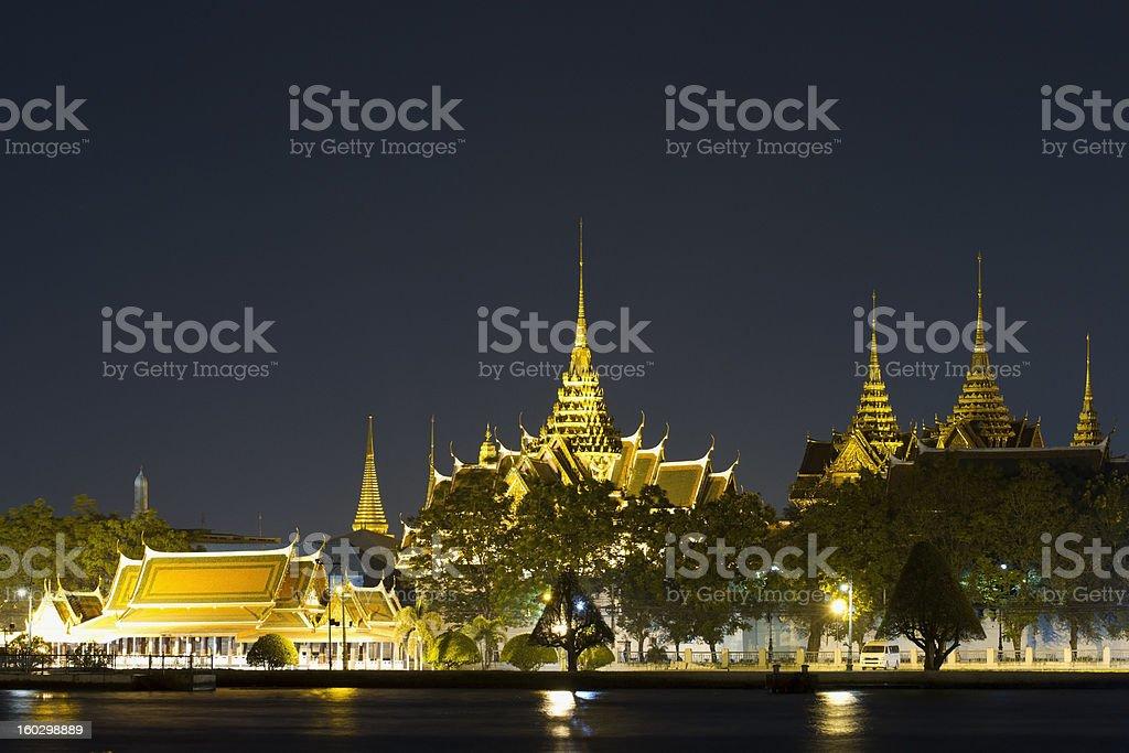 Grand Palace across Chao Phraya River royalty-free stock photo