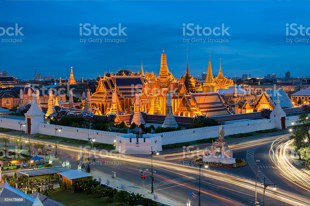 Grand palace with traffic light at dusk stock photo