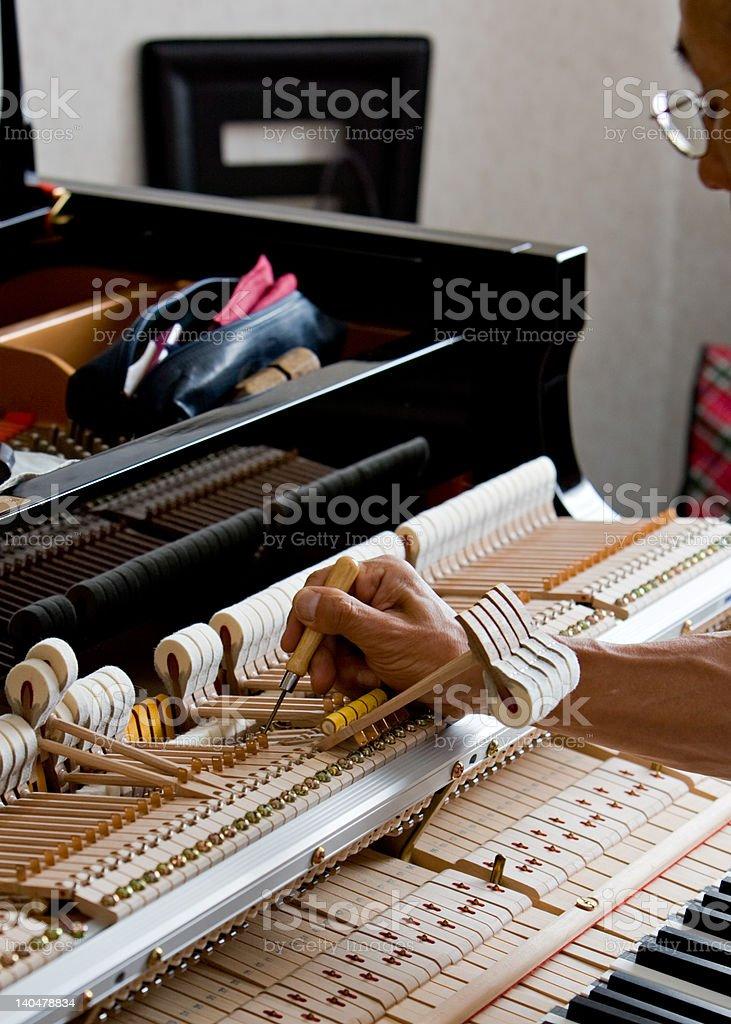 Grand piano adjustments stock photo