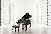 Piano in empty white room