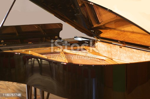 a beautifully polished grand piano... looking inside at the strings