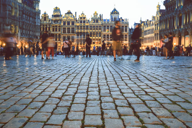 Grand place Brussels, Belgium Selective focus on stone pavement at Grand place Brussels, Belgium brussels capital region stock pictures, royalty-free photos & images