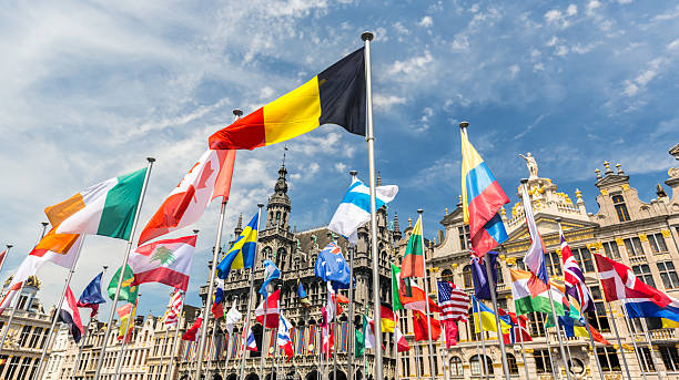 Grand Place in Brussels with many international flags - Photo