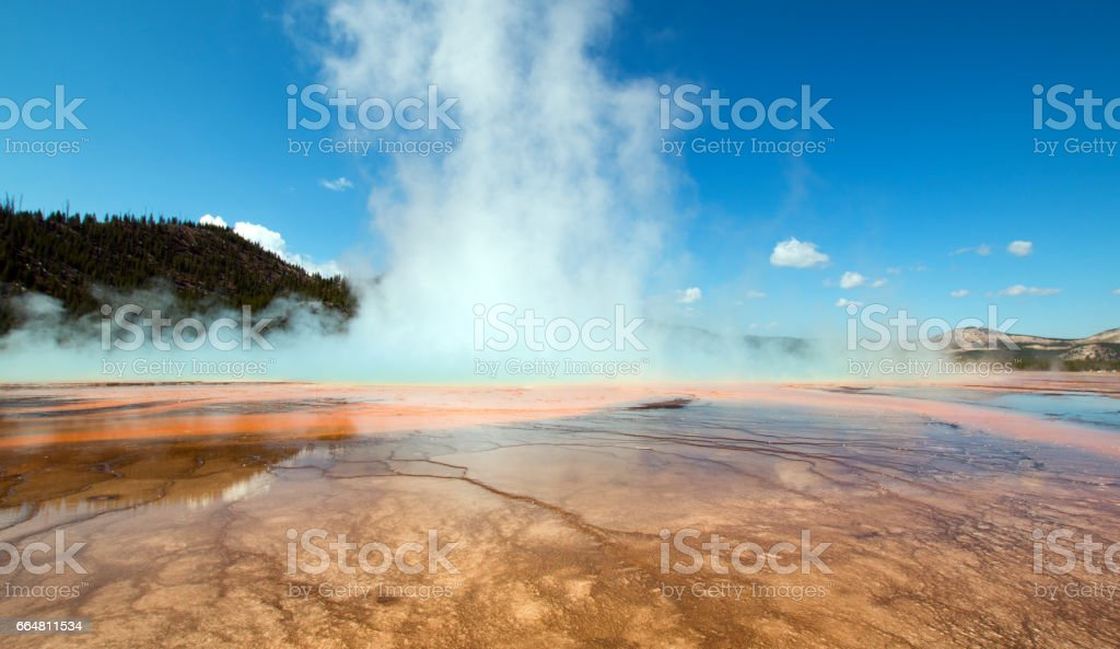 Grand Prismatic Spring during the day in the Midway Geyser Basin in Yellowstone National Park in Wyoming USA stock photo