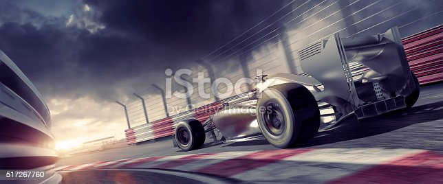 A close up low angle, cross processed image of a racing car moving at high speed on a racetrack. The action occurs during a race under a stormy overcast sky in the evening, at sunset, during a racing event. The location is fictional and the car in CG generated.