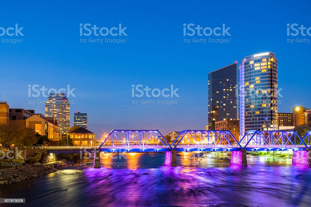 Grand Rapids downtown including river and bridge at dusk stock photo