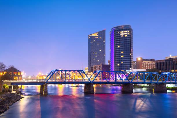 Grand Rapids, Michigan, USA downtown skyline on the Grand River stock photo