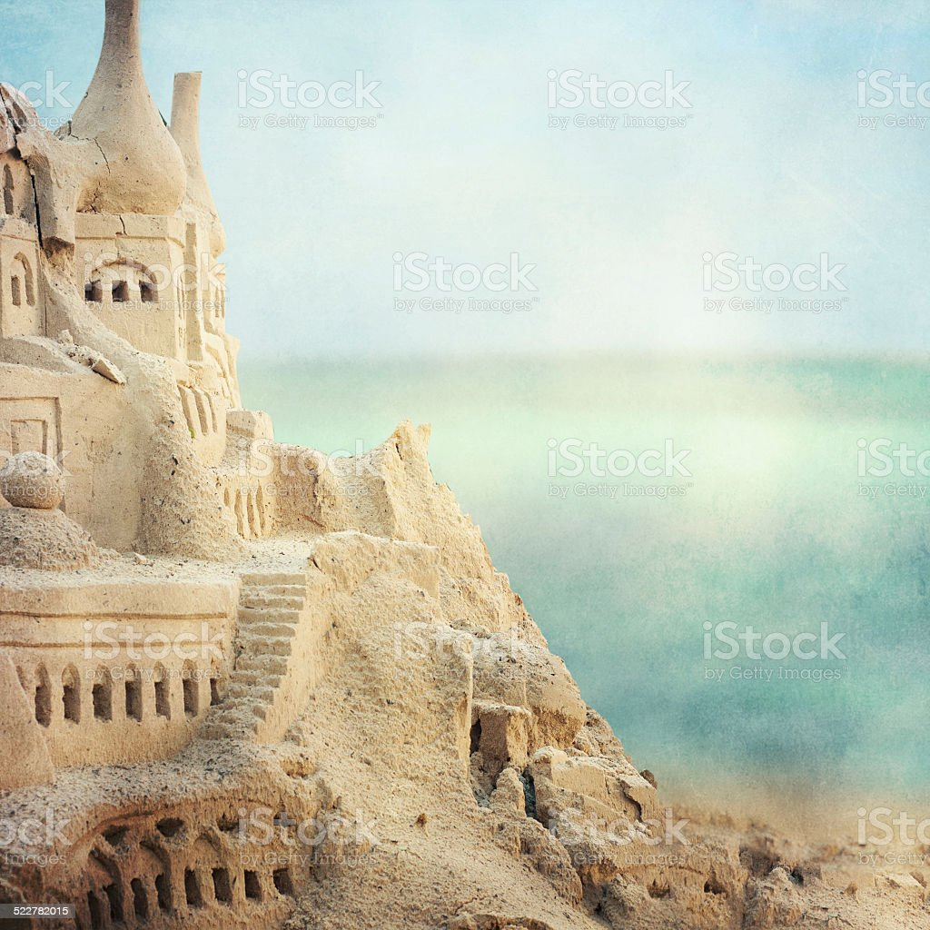 Grand sandcastle on the beach stock photo