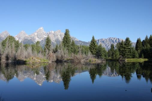 Grand Teton Mountain Range Reflecting In Lake Stock Photo - Download Image Now