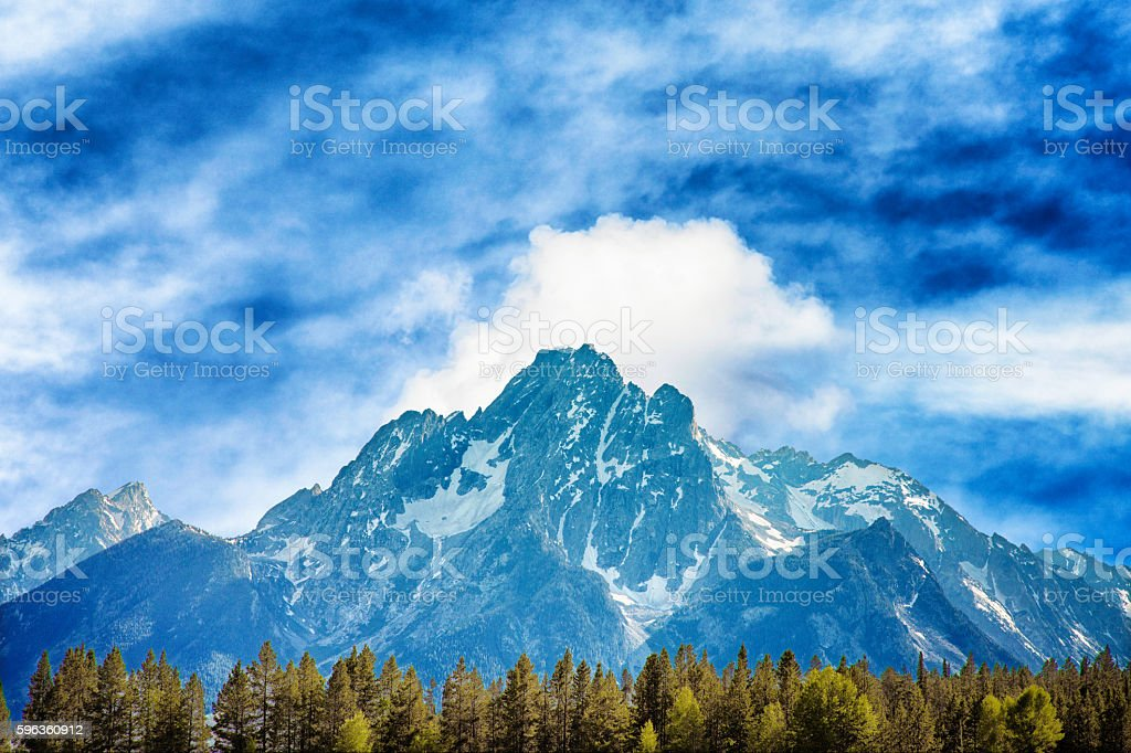 Grand Teton mountain range under cloudy sky royalty-free stock photo