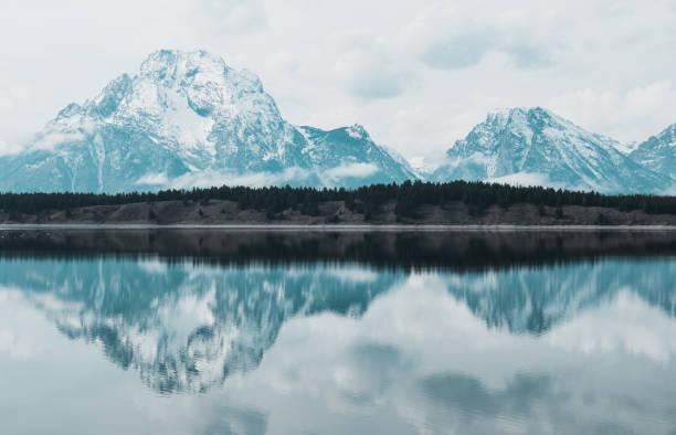 Grand Teton Mountain reflection and lake stock photo