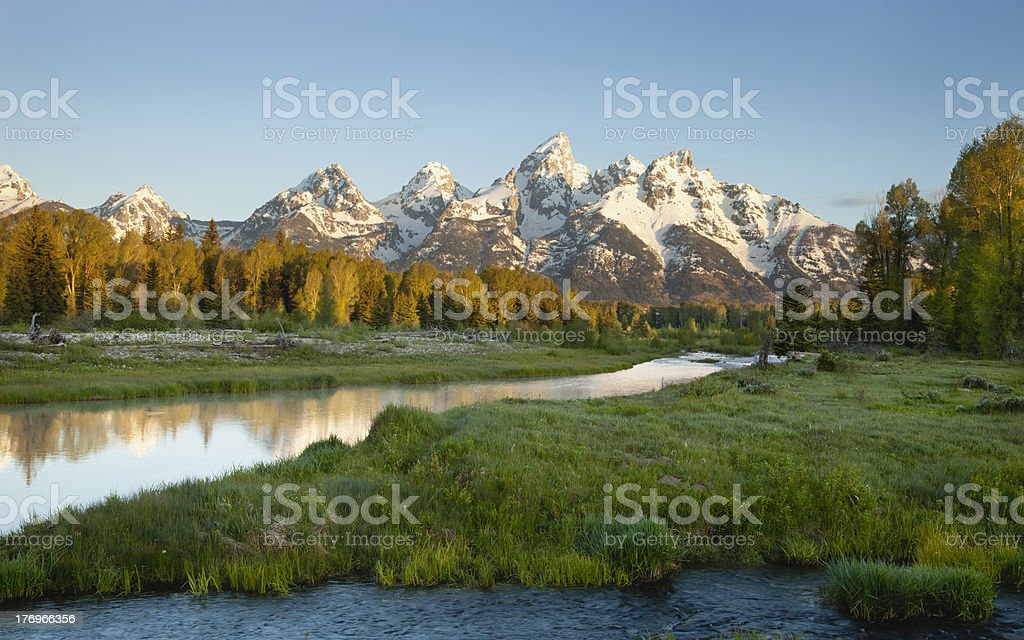 Grand Teton mountains in morning light with river royalty-free stock photo