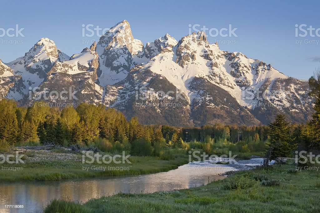 Grand Teton mountains with stream in morning light royalty-free stock photo