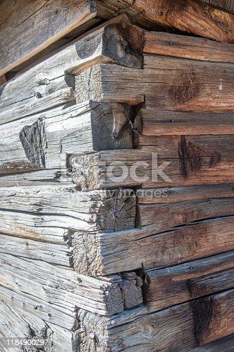 Broken down historic log shelter near the Teton mountain range