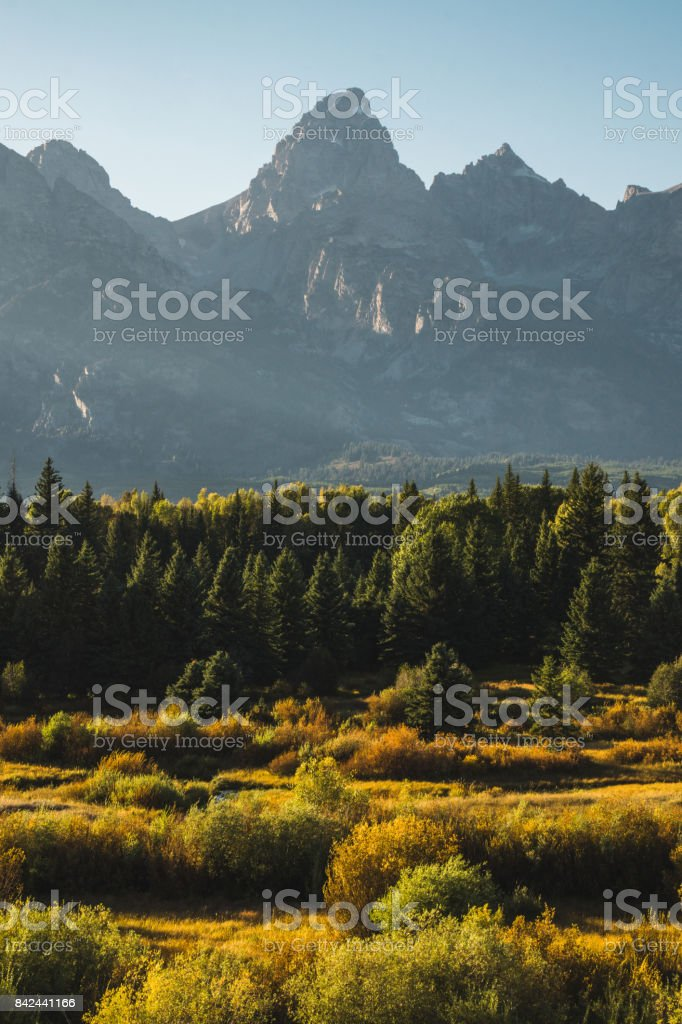 Grand Teton, the Snake River and surrounding forest  on an early autumn afternoon stock photo
