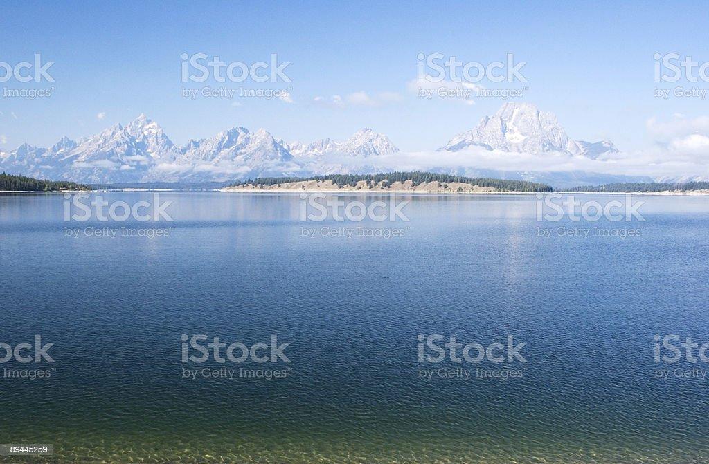 Grand Tetons across water royalty-free stock photo